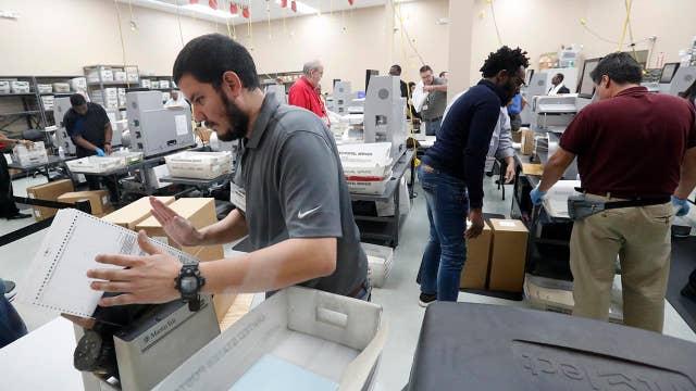 Machines overheat, lawsuits loom as recount deadline nears