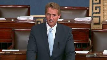 Sen. Flake threatens judicial nominations to protect Mueller