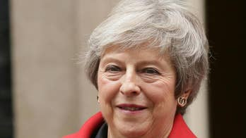 Theresa May fights for political survival after draft Brexit deal sparks resignations, calls for her ouster