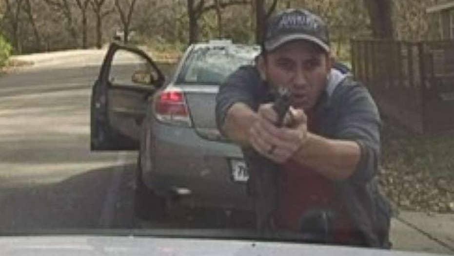 Dramatic video: police dashcam captures dangerous shootout