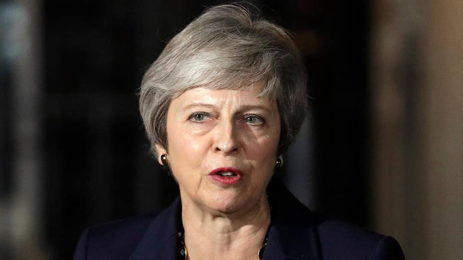 May's Brexit plan prompts backlash and resignations