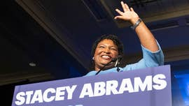 Stacey Abrams says she can't defeat Brian Kemp in Georgia governor race; will sue over mismanagement of state's election