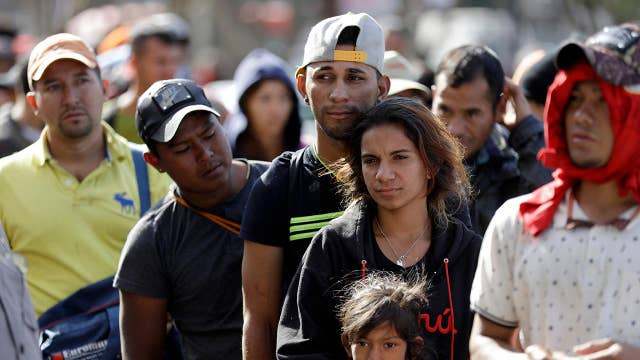 New questions about caravan as migrants arrive in Tijuana