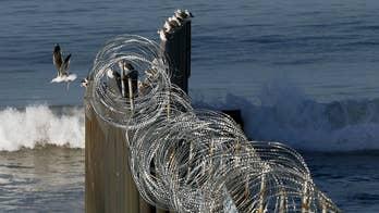 Government shutdown threats over border wall, Mueller probe