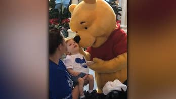 Winnie the Pooh shares tender moment with disabled child