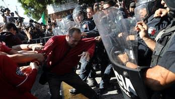 Anti-caravan protesters clash with police in Tijuana