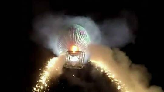 Hot air balloon filled with fireworks explodes in midair