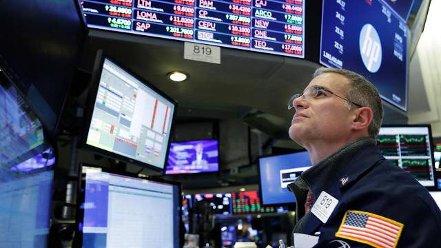 Dow plummets from all-time high, erasing year's gains