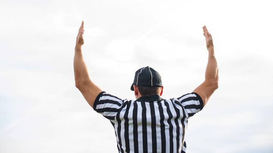 Football: High schooler's parent accused of wearing referee uniform