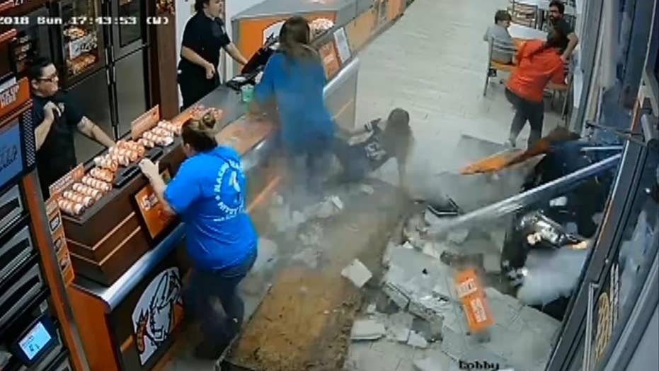 Little Caesars customers dive out of way as car smashes ...