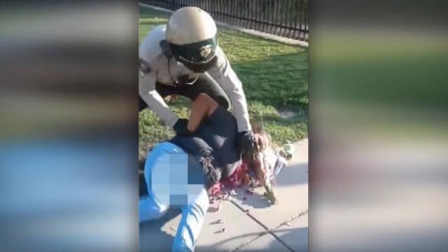 Violent arrest of woman selling flowers caught on camera