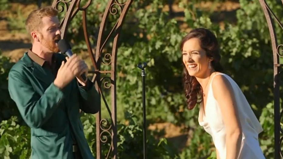 Bride and groom perform wedding vows as epic rap battle