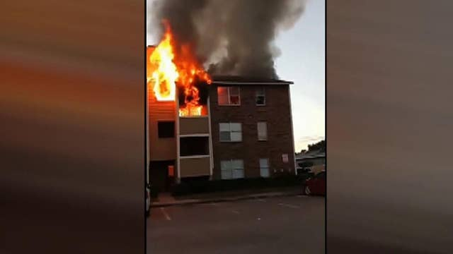 Raw Video: People jump to escape burning building