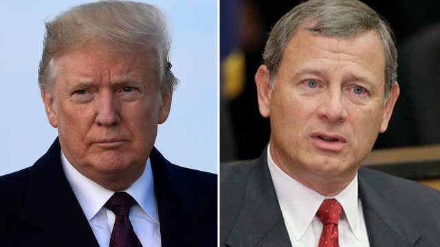 Trump, Chief Justice Roberts spar over role of judges