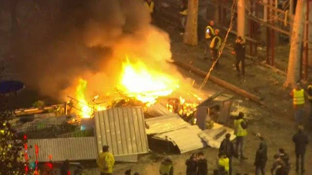 Gas-price protesters burn scaffolding in Paris