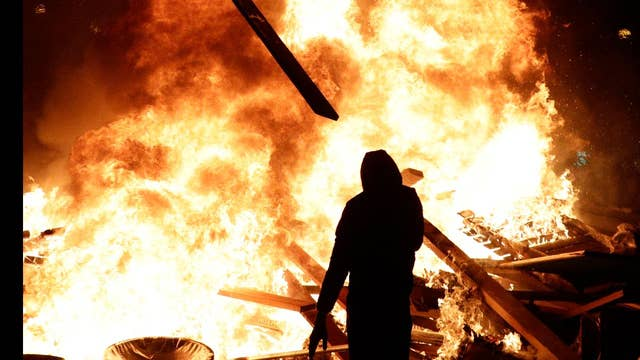 Police and protesters clash in Paris over gas prices