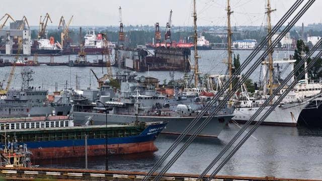 Russian military open fire, seize Ukrainian naval vessels