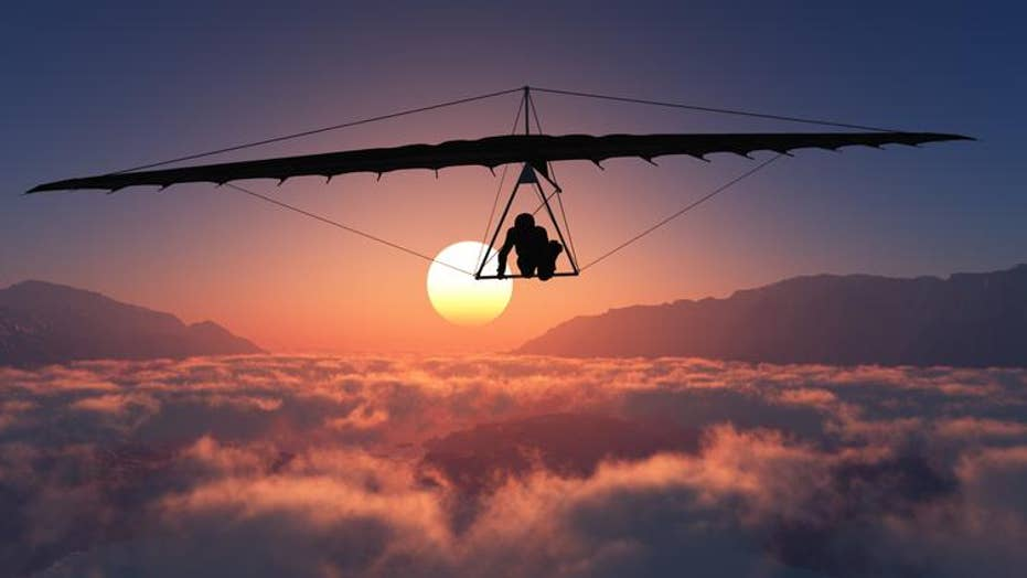 Hang-glider forced to hold on for his life