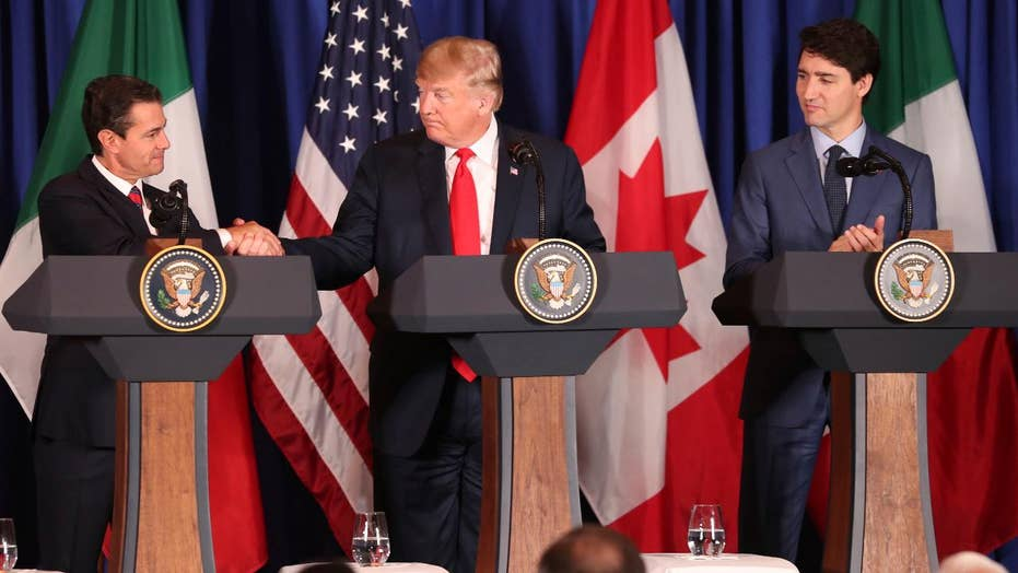 President Trump signs trade deal with Mexico, Canada