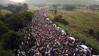 Caravan migrants begin to breach border as frustration with slow asylum process grows