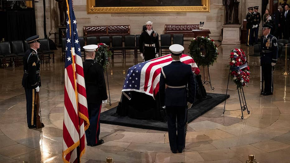 George H.W. Bush lies in state in Capitol Rotunda