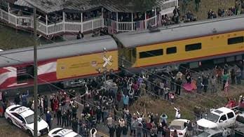 Members of the public salute Bush 41's funeral train