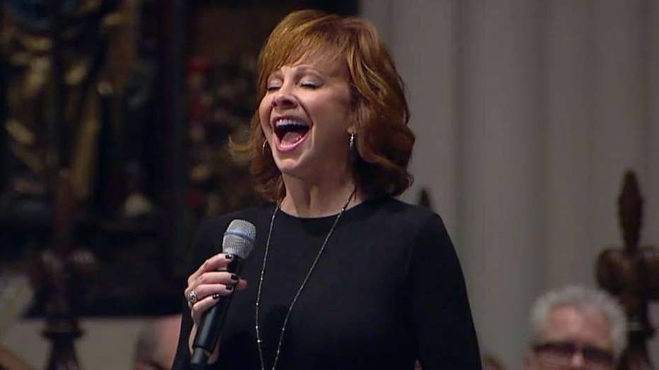 Reba McEntire sings 'The Lord's Prayer' at Bush's funeral