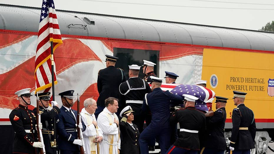 George H.W. Bush's casket carried onto funeral train