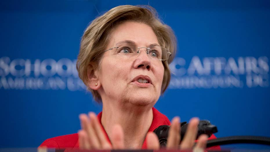 Warren stands by argumentative DNA test