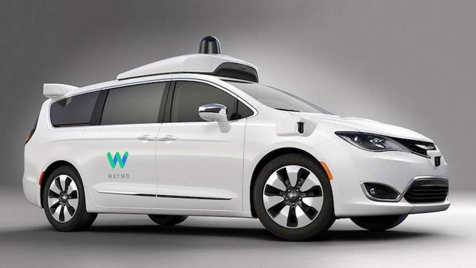 Alphabet launches self-driving cab use Waymo