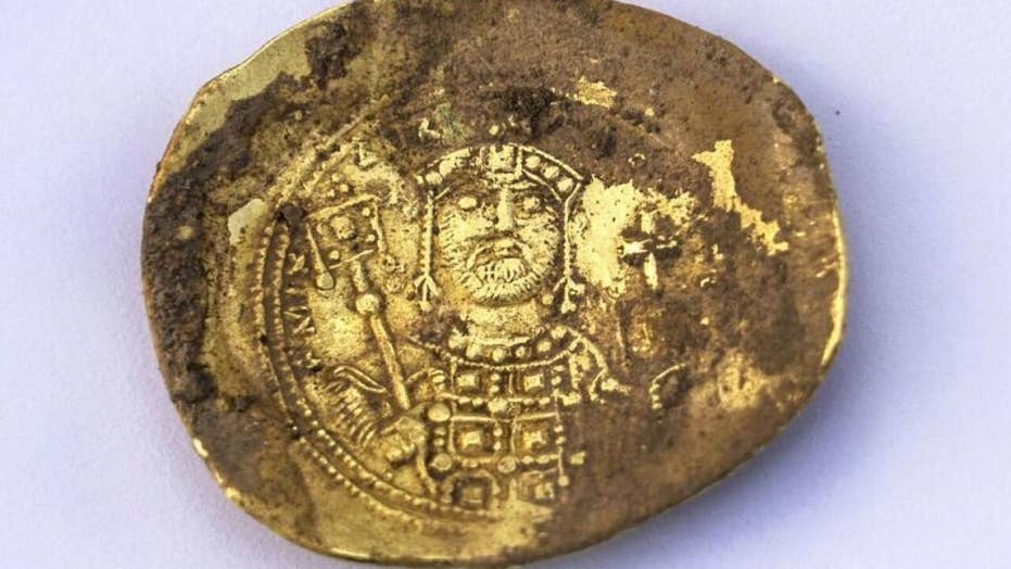 Trove of coins and 900-year-old earring found at massacre site