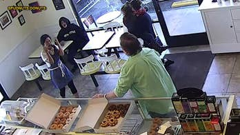 Homeless woman throws hot coffee at doughnut shop owner's face
