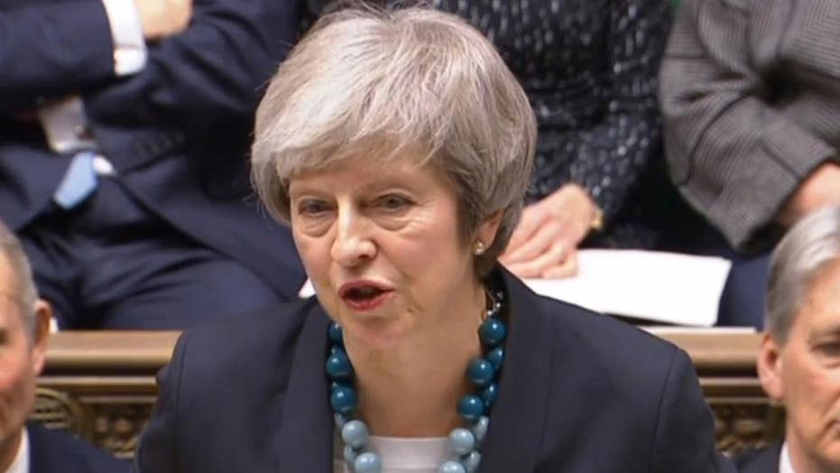 British PM May delays crucial vote on Brexit deal