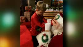 Photos capture heartwarming moment blind boy meets Santa, reindeer
