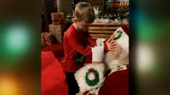Photos capture heartwarming moment blind boy meets Santa, reindeer