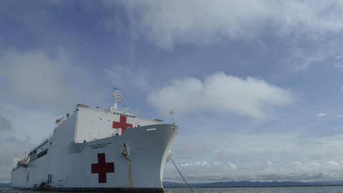 Floating Navy hospital ship treating migrants