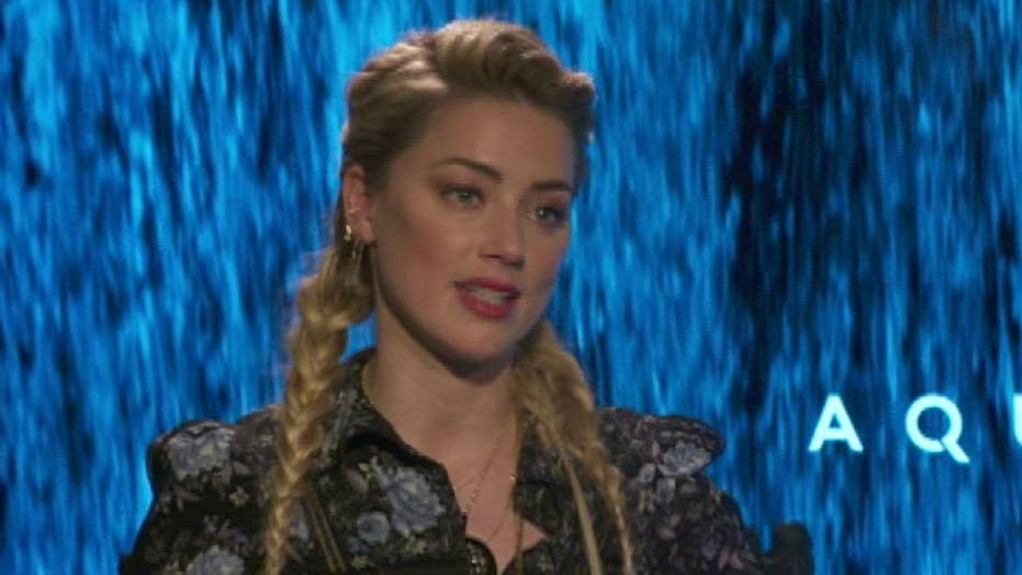 Amber Heard talks superhero roles for women