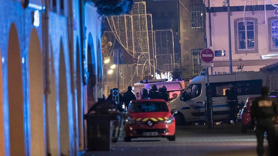 Five detained in manhunt for gunman in France attack
