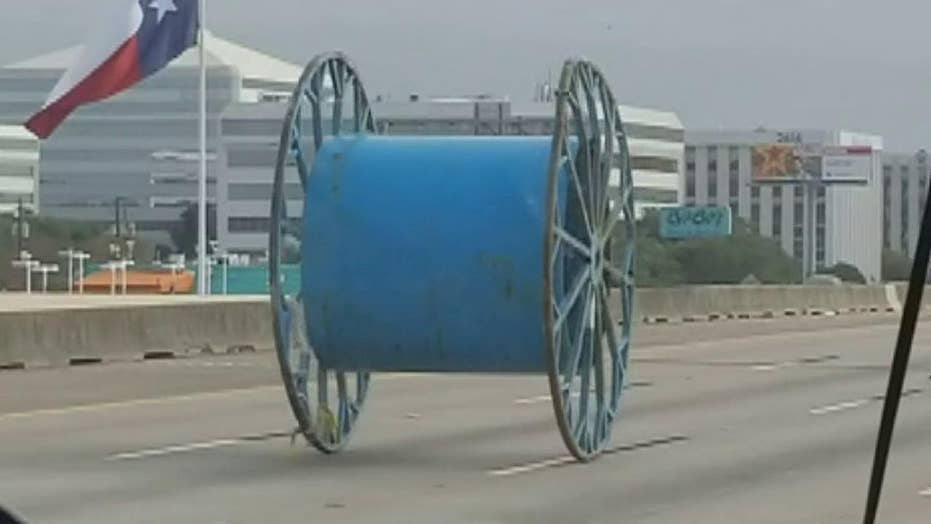 Giant industrial spool rolls down Houston highway