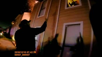 Body cam video shows police officers catching boy who jumped from burning apartment
