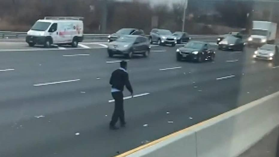 Chaos on New Jersey highway after armored truck spills cash