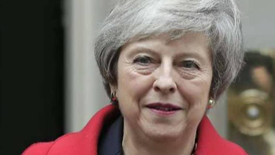 British PM May survives no-confidence vote