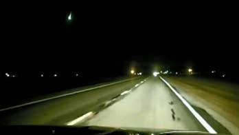 Huge green fireball from Geminid meteor shower captured on Indiana officer's dash cam
