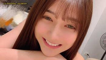 Taiwan woman dubbed 'most beautiful fishmonger'