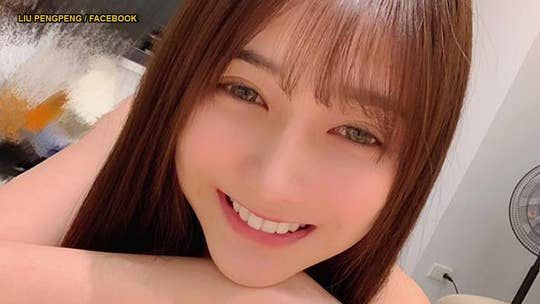 Woman called Taiwan's 'most beautiful fishmonger' after photos pop up online