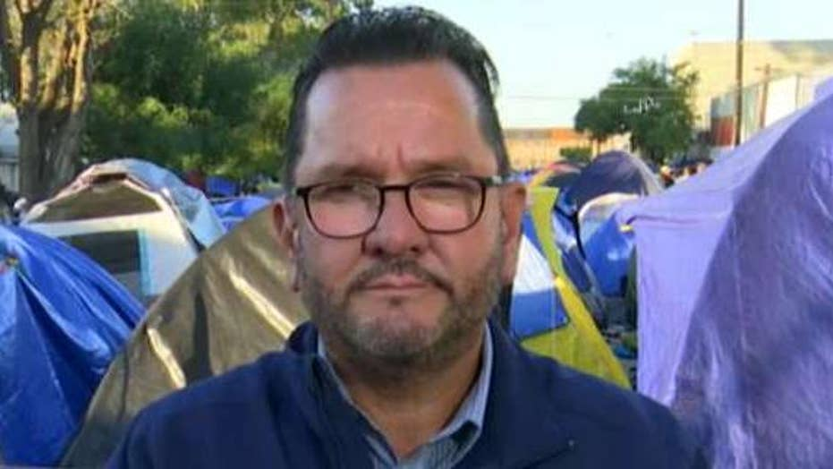 Tijuana official: Some caravan migrants breaking into homes