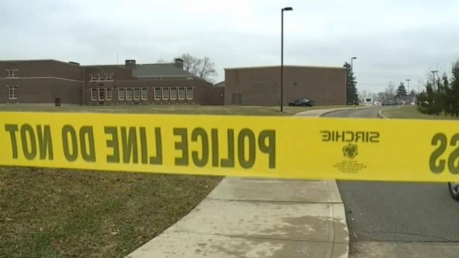Police confront teen gunman at Indiana middle school