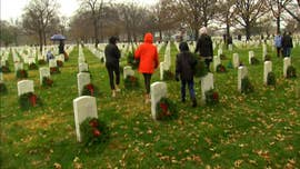 Trump joins Wreaths Across America in laying wreaths at Arlington National Cemetery