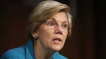 Elizabeth Warren warns black graduates the 'system is rigged'