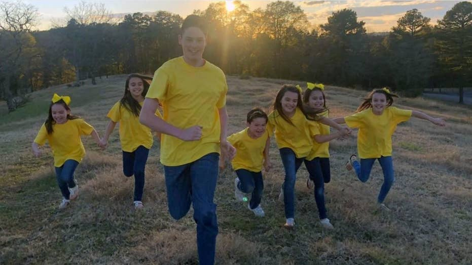 Arkansas couple adopts seven siblings at once, giving them a 'forever family' ahead of Christmas